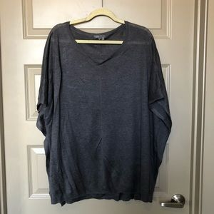 Sweater poncho with light material